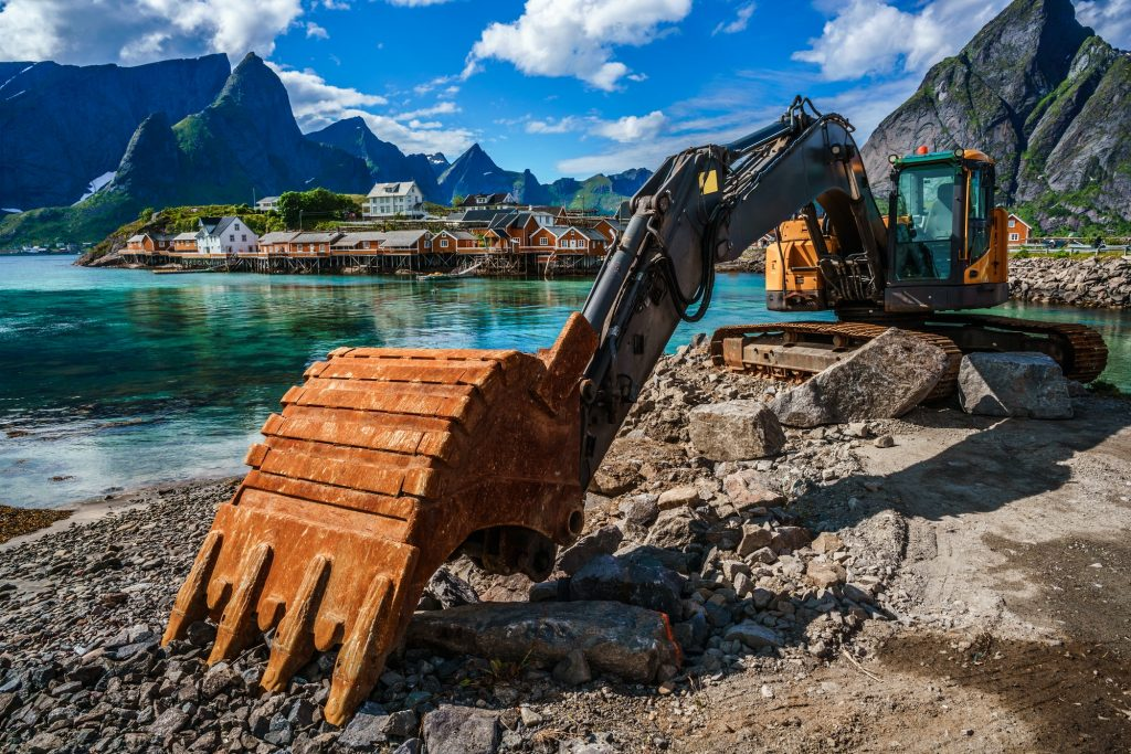 Excavator, bulldozer repair work on the road. Norway