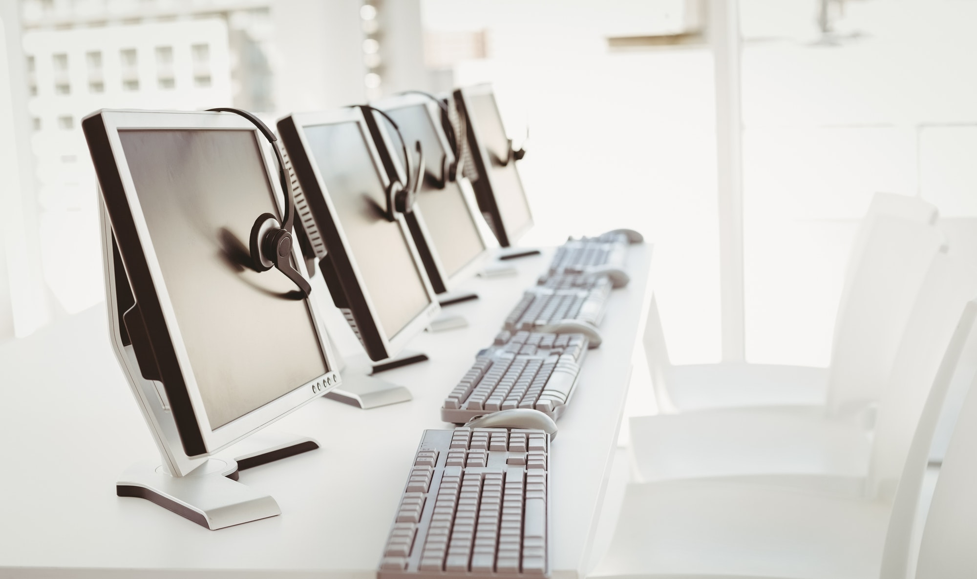 Call center computers and headsets all in a row